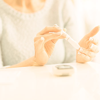 Women Using Diabetes test strip